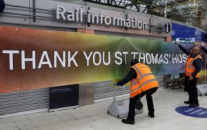ASSOCIATED PRESS                                 Staff at Waterloo Station in London put up a banner to thank nearby St Thomas' Hospital, Tuesday. The highly contagious COVID-19 coronavirus has impacted on nations around the globe, many imposing self-isolation and exercising social distancing when people move from their homes.