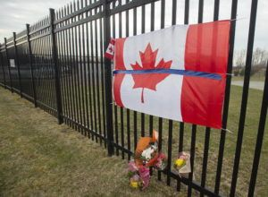 THE CANADIAN PRESS VIA ASSOCIATED PRESS                                 A tribute is displayed today at the Royal Canadian Mounted Police headquarters in Dartmouth, Nova Scotia, following a weekend shooting rampage by a gunman, disguised as a police officer, that killed multiple people including an RCMP constable.