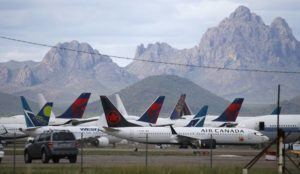 ASSOCIATED PRESS                                 Airplanes sit parked at Pinal Airpark in Red Rock, Ariz., on March 18.