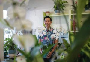 CINDY ELLEN RUSSELL / CRUSSELL@STARADVERTISER.COM                                  Reece Farinas of family-owned Beretania Florist said he was excited by the news that flower shops would be able to reopen for Mother's Day after Gov. David Ige reversed an earlier edict. Florists now may resume operations Friday. Mother's Day is May 10.