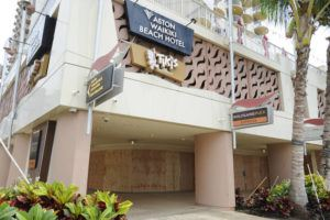 BRUCE ASATO / BASATO@STARADVERTISER.COM                                 Closed and boarded up shops at Aston Waikiki Beach Hotel.