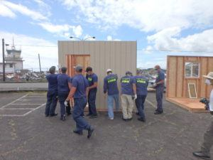 COURTESY PHOTO                                 The volunteers, with guidance from HPM Building Supply, constructed 32 8-feet by 10-feet shelters for the Hale Hanakahi Emergency Shelter facility.
