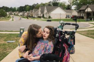 NEW YORK TIMES                                 Susan Lee, a special education teacher, was with her 12-year-old daughter Alyssa, outside their home in Pelham, Ala., earlier this week.