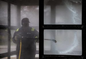 NEW YORK TIMES                                 A City of Detroit Department of Transportation worker power washes a bus stop in Detroit on March 27, 2020.