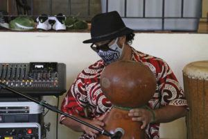 ASSOCIATED PRESS                                 Justin Chang played a gourd during a livestream performance of his family's band, Kanilau, from the living room of his father Roland Chang's home in Honolulu on May 5. The coronavirus pandemic has taken out large sections of Hawaii's tourism-based economy, including the Chang family's turtle and dolphin snorkel tour business and their regular music gig in Waikiki.