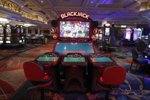 ASSOCIATED PRESS Chairs are removed to keep social distancing between players as a coronavirus safety precaution at an electronic gaming machine in the closed Bellagio hotel and casino, Wednesday, in Las Vegas.