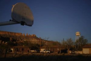 ASSOCIATED PRESS                                 The water tower and a basketball backboard at the school in Chilchinbeto, Ariz., on the Navajo reservation, are seen at sunrise.