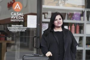 ASSOCIATED PRESS Christa Schall poses outside her cosmetology school, Casal Aveda Institute, in Austintown, Ohio.