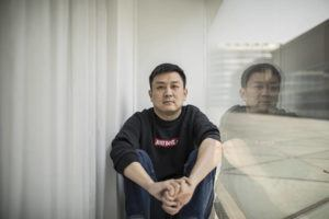 ASSOCIATED PRESS                                 U.S. citizen Daniel Hsu posed for a portrait in the apartment he has been renting in Shanghai, China, April 13. Friends offered Hsu jobs or money to start a restaurant in Shanghai. But he always declined, worried he'd get them in trouble. He couldn't work legally because he had a U.S. passport with an expired visa and the Anhui authorities wouldn't give him paperwork needed to get a new one.