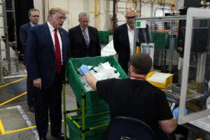 ASSOCIATED PRESS                                 President Donald Trump participates in a tour of a Honeywell International plant that manufactures personal protective equipment today in Phoenix, with Tony Stallings, vice president of Integrated Supply Chain at Honeywell, right and White House chief of staff Mark Meadows.