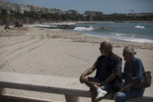 ASSOCIATED PRESS The deserted Croisette beach is pictured empty due to measures put in place to stop the spread of the coronavirus in Cannes, southern France, today.