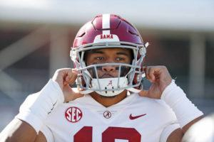 ASSOCIATED PRESS Alabama quarterback Tua Tagovailoa adjusted his helmet, Nov. 16, before a game against Mississippi State in Starkville, Miss. A day after agreeing to terms on a four-year, $30.2 million NFL contract, Tua Tagovialoa said he plans to start charity efforts in Hawaii and elsewhere.
