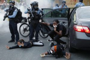 ASSOCIATED PRESS                                 Motorists are ordered to the ground from their vehicle by police during a protest on South Washington Street on Sunday in Minneapolis. Protests continued following the death of George Floyd, who died after being restrained by Minneapolis police officers on Memorial Day.