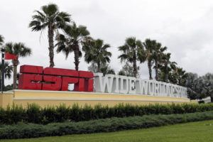 ASSOCIATED PRESS                                 A sign marking the entrance to ESPN's Wide World of Sports at Walt Disney World is seen Wednesday in Kissimmee, Fla. The NBA has told the National Basketball Players Association that it will present a 22-team plan for restarting the season at Disney.