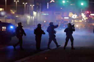 ASSOCIATED PRESS                                 Police walk through tear gas as they try to disperse protesters in Las Vegas on May 30. Three Nevada men with ties to a loose movement of right-wing extremists advocating the overthrow of the U.S. government have been arrested on terror charges in what authorities say was a conspiracy to spark violence during recent protests.