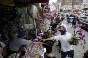 ASSOCIATED PRESS Balloons and flowers are sold on Mother's Day at the Los Angeles Flower Market on Sunday in Los Angeles. Families in the U.S. and elsewhere marked Mother's Day in a time of social distancing and isolation due to the coronavirus pandemic.