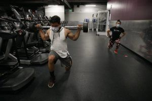 ASSOCIATED PRESS People wore masks, June 26, while exercising at a gym in Los Angeles. The World Health Organization, today, acknowledged the possibility that COVID-19 might be spread in the air under certain conditions — after more than 200 scientists urged the agency to do so.