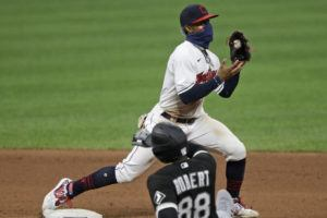 ASSOCIATED PRESS                                 Cleveland Indians' Francisco Lindor gets Chicago White Sox's Luis Robert at second base in the seventh inning in the second baseball game of a doubleheader Tuesday in Cleveland.