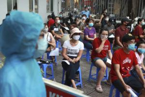 ASSOCIATED PRESS                                 People wait in line for COVID-19 test in Hanoi, Vietnam. Vietnam reported on Friday the country's first ever death of a person with the coronavirus as it struggles with a renewed outbreak after 99 days without any cases.
