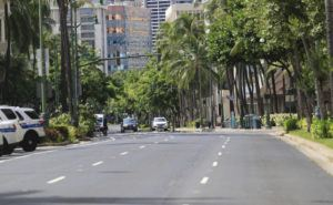 JAMM AQUINO / SEPT. 8                                 A nearly empty Kalakaua Avenue in Waikiki. Oahu beaches and parks reopened Thursday for solo activities such as walking, eating and sitting alone.