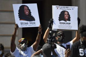 ASSOCIATED PRESS                                 Signs were held up showing Breonna Taylor during a rally in her honor on the steps of the Kentucky State Capitol in Frankfort, Ky., June 25. The city of Louisville will pay $12 million to the family of Breonna Taylor and reform police practices as part of a lawsuit settlement months after Taylor's slaying by police thrust the Black woman's name to the forefront of a national reckoning on race, Mayor Greg Fischer announced today.