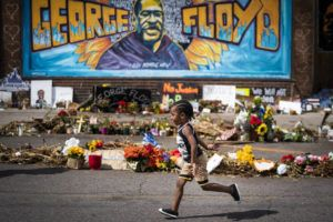 LEILA NAVIDI/STAR TRIBUNE VIA AP / JUNE 25                                 Carter Sims, 3, of Pine Island, Minn., runs past a mural at the George Floyd memorial outside Cup Foods in Minneapolis. A stretch of a Minneapolis street that includes the place where Floyd was killed will soon be named in his honor. The City Council approved the naming Friday, Sept. 18, and Mayor Jacob Frey's office said he would likely sign off on it as well.