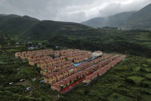 ASSOCIATED PRESS                                 An aerial view, Sept. 10, showed new village houses built by the Chinese government for ethnic minority in Ganluo county, southwest China's Sichuan province. China's ruling Communist Party says its initiatives have helped to lift millions of people out of poverty.