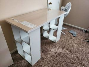 ASSOCIATED PRESS / SEPTEMBER 14                                 A desk constructed out of a legless tabletop and bookcases stands in an Indianapolis home.