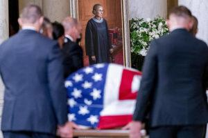 ASSOCIATED PRESS                                 The flag-draped casket of Justice Ruth Bader Ginsburg, carried by Supreme Court police officers, arrives in the Great Hall at the Supreme Court in Washington. Ginsburg, 87, died of cancer on Sept. 18.