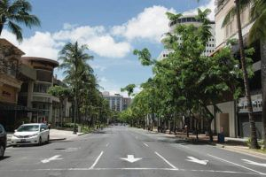 CRAIG T. KOJIMA / AUG. 21                                 Only 22,562 visitors flew to Hawaii in July, which last year was Hawaii's best tourism month. Above, normally busy Kalakaua Avenue in Waikiki has no traffic.
