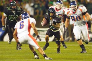 """STAR-ADVERTISER / 2003                                 Chad Owens hosts the """"The CO2 RUN DWN,"""" the Honolulu Star-Advertiser's new Facebook Live sports talk show. Owens is shown here attempting to break another play wide open against Boise State."""