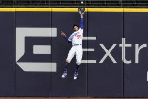ASSOCIATED PRESS                                 Los Angeles Dodgers right fielder Mookie Betts robs Atlanta Braves' Marcell Ozuna of a home during the fifth inning in Game 6 of the National League Championship Series today in Arlington, Texas.