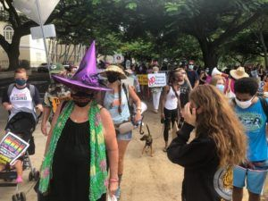 CRAIG T. KOJIMA / CKOJIMA@STARADVERTISER.COM                                 Hundreds of women and men marched today in Honolulu as part of a nationwide protest against the Trump administration and its policies.
