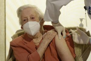 ASSOCIATED PRESS                                 World War II veteran Emilie Repikova receives a vaccine against COVID-19 at the military hospital in Prague, Czech Republic.