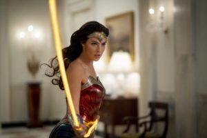 """WARNER BROS. VIA AP                                 This image released by Warner Bros. Entertainment shows Gal Gadot in a scene from """"Wonder Woman 1984."""" The superhero sequel earned an estimated $38.5 million in ticket sales from international theaters, Warner Bros. said today."""