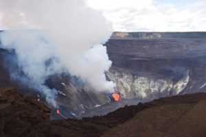 COURTESY USGS VIA AP                                 Plumes rise from active fissures in Halemaumau crater of Kilauea volcano on Tuesday. Lava is rising more than 3 feet an hour in the crater from the lava vents that erupted Sunday night. The increased activity has been a welcome boon to at least one Hawaii helicopter tour company.