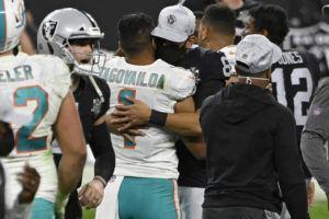 ASSOCIATED PRESS                                 Miami Dolphins quarterback Tua Tagovailoa (1) embraces Las Vegas Raiders quarterback Marcus Mariota (8) after the game.