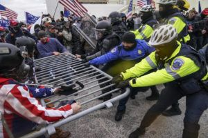 ASSOCIATED PRESS                                 Trump supporters tried to break through a police barrier, Wednesday, at the Capitol in Washington.