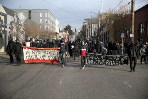 ASSOCIATED PRESS                                 Demonstrators march during a protest on Inauguration Day in Southeast Portland, Ore.