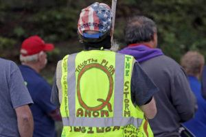 ASSOCIATED PRESS                                 A person wears a vest supporting QAnon at a protest rally in Olympia, Wash., on May 14.