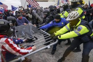 ASSOCIATED PRESS Trump supporters try to break through a police barrier today in Washington.