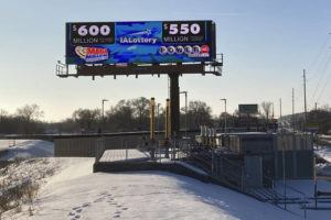 ASSOCIATED PRESS                                 A digital billboard in Des Moines, Iowa, on Monday, shows jackpots for the Mega Millions and Powerball games.