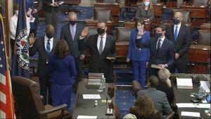 SENATE TELEVISION VIA AP                                 In this image from video, Vice President Kamala Harris swears in Sen. Raphael Warnock, D-Ga., Sen. Alex Padilla, D-Calif., and Sen. Jon Ossoff, D-Ga., on the floor of the Senate on Capitol Hill in Washington.