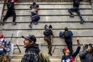 NEW YORK TIMES Protestors climb onto the U.S. Capitol in Washington on Wednesday.