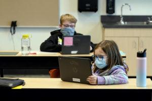 ASSOCIATED PRESS                                 Students wore masks, Feb. 2, as they worked in a fourth-grade classroom, at Elk Ridge Elementary School in Buckley, Wash. Amid mounting tensions about school reopening, the Centers for Disease Control and Prevention released long-awaited guidance, today, on what measures are needed to get children back into the classroom during the pandemic.