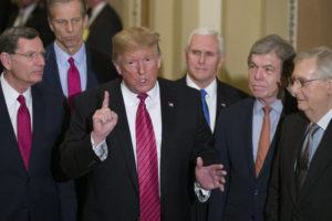 ASSOCIATED PRESS / 2019                                 Sen. John Barrasso, R-Wyo., left, and Sen. John Thune, R-S.D., stand with President Donald Trump, Vice President Mike Pence, Sen. Roy Blunt, R-Mo., and Senate Majority Leader Mitch McConnell of Ky., as Trump speaks while departing after a Senate Republican Policy luncheon, on Capitol Hill in Washington.