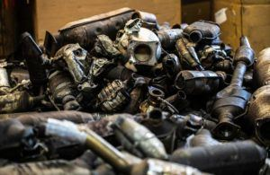 JEENAH MOON/THE NEW YORK TIMES                                 A pile of catalytic converters, which contain palladium, at Alpha Recycling in the Bronx, in Dec. 2018. Palladium, a silvery-white metal, used in cars and sometimes jewelry, has topped gold in commodities trading.