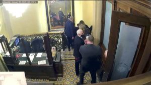 ASSOCIATED PRESS                                 A security video shows Vice President Mike Pence being evacuated on Jan. 6 as rioters breach the Capitol. The video was shown during the second impeachment trial of former President Donald Trump in the Senate at the U.S. Capitol in Washington Wednesday.