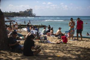 """CINDY ELLEN RUSSELL / MARCH 19                                 Beachgoers enjoy the sun, sand and surf at the Kuhio Beach in Waikiki. Leaders in the state Legislature are depending on tourism to bring jobs and state revenues back to pre-pandemic levels. <a href=""""https://www.staradvertiser.com/2021/03/23/hawaii-news/economic-recovery-rosy-with-billions-in-federal-aid-set-to-roll-into-hawaii/"""" target=""""_self"""">Read more.</a><a href=""""https://www.staradvertiser.com/2021/03/23/hawaii-news/economic-recovery-rosy-with-billions-in-federal-aid-set-to-roll-into-hawaii/"""" target=""""_self""""> </a>"""