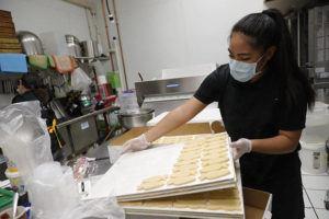 JAMM AQUINO / APRIL 3                                 A Cake Life boutique bakery worker Tiffany Waikiki checks on Easter cookies. The award-winning custom cake shop is among thousands of vendors in Hawaii's wedding industry whose businesses have been hit hard due to the coronavirus pandemic.